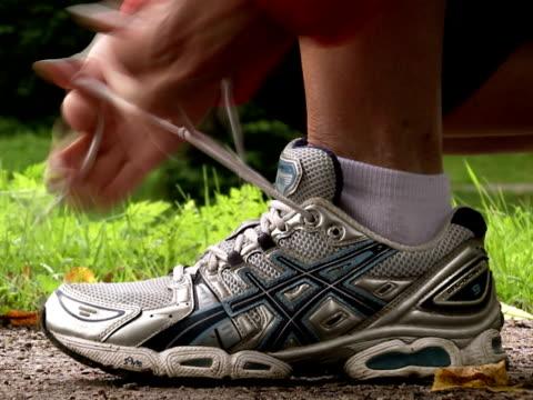 A female jogger tying her shoelace Stockholm Sweden.