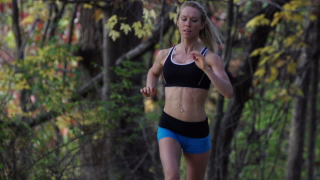female jogger - cross country running stock videos and b-roll footage