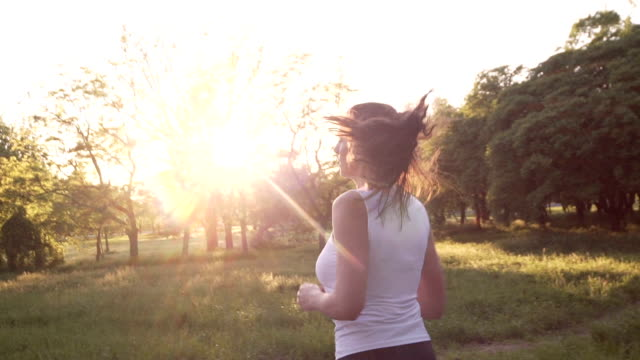 Female Jogger Woman Running at Sunset