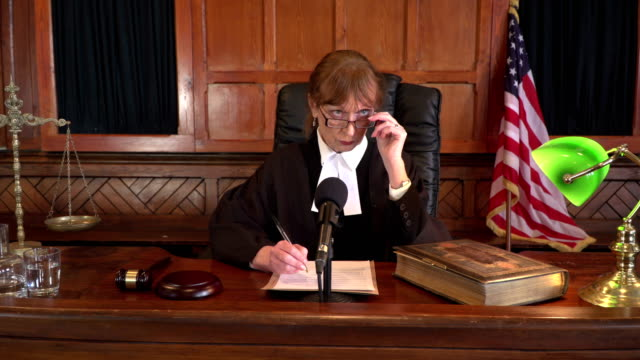 4K DOLLY: USA Female Judge in Court listening to case
