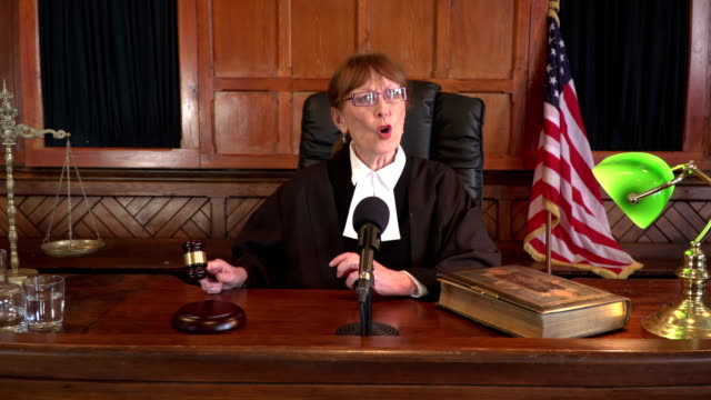4K DOLLY: USA Female Judge in Courthouse using Gavel