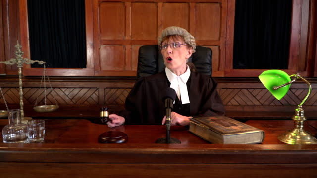 4k dolly: female judge in courtroom calling order - judges stock videos and b-roll footage