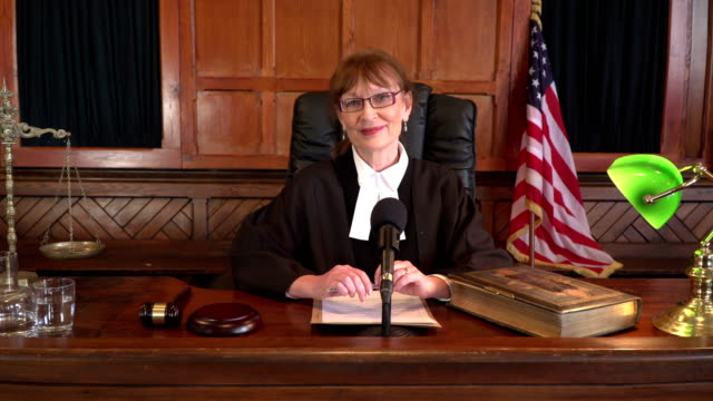 4K DOLLY: USA Female Judge in Courtroom smiling at the camera