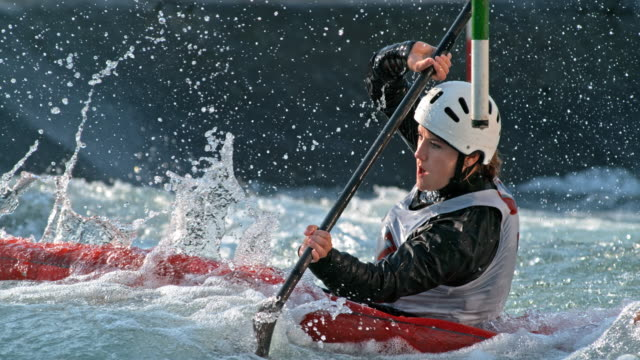 slo mo female kayaker competing on the slalom course - oar stock videos & royalty-free footage