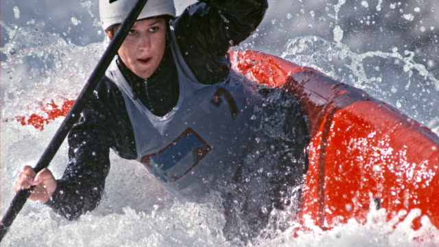 slo mo female kayaker navigating through whitewater of a slalom course - kayak stock videos & royalty-free footage