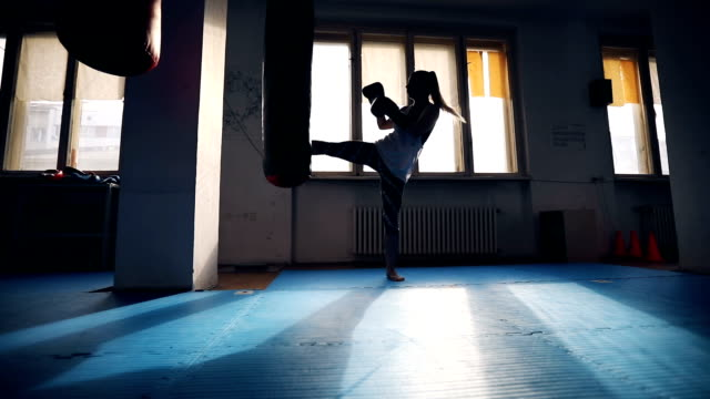 female kick-boxer training - martial arts stock videos & royalty-free footage