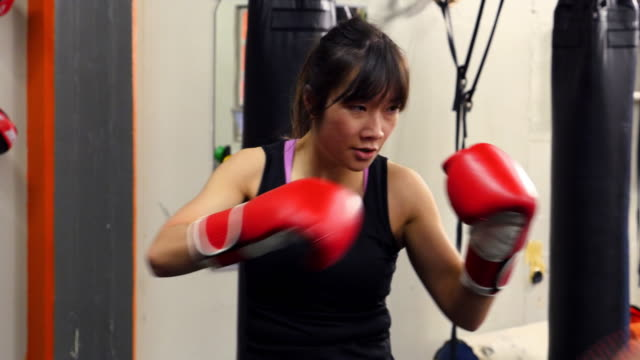 MS PAN Female kickboxer working out in fighting gym