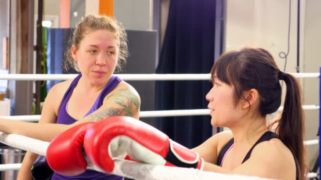 MS Female kickboxers training together in ring in gym