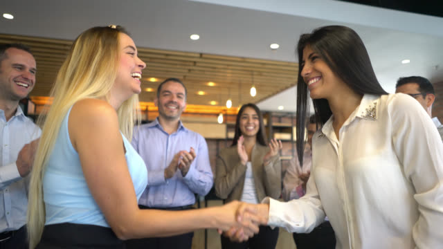 female leader congratulating a new hire at the office - handshake stock videos & royalty-free footage
