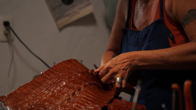 ms female leatherworker preparing leather before starting project in workshop - shears stock videos & royalty-free footage