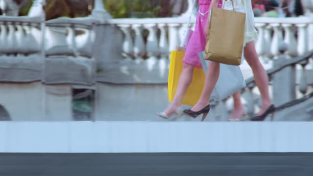 ts female legs in high heels on a shopping spree - blonde hair stock videos & royalty-free footage