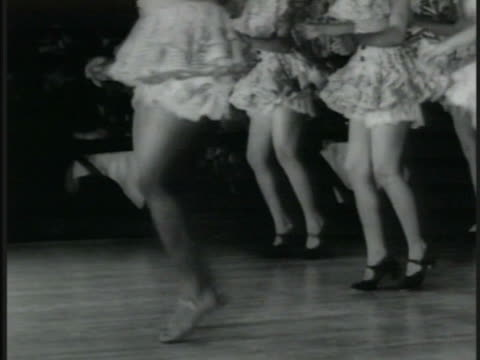 female legs in short skirts tap dancing on stage, lead female legs are woman of color, black, african-american. - tänzerin stock-videos und b-roll-filmmaterial