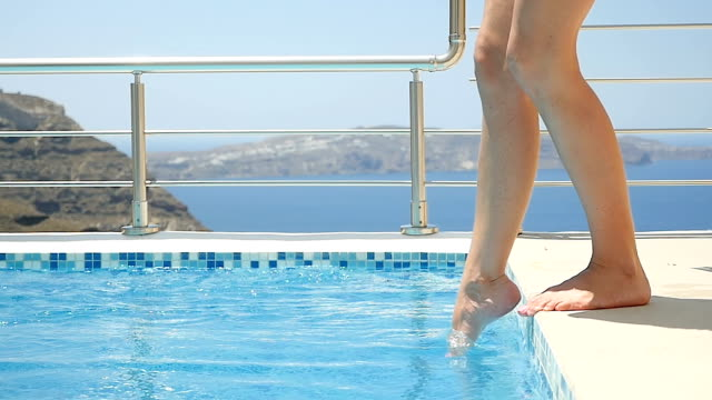 female legs splashing the pool water - dipping stock videos & royalty-free footage