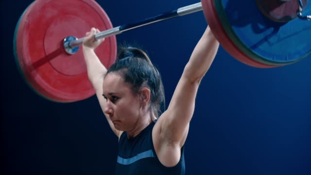slo mo tu female lifter doing the snatch - endurance stock videos & royalty-free footage