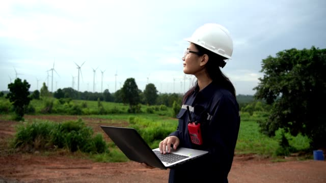 female maintenance engineers in uniform work in wind turbine farms - environmental conservation stock videos & royalty-free footage
