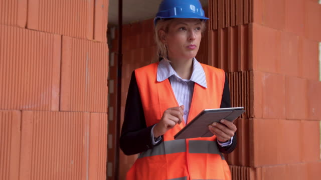 Female manager analysing construction site