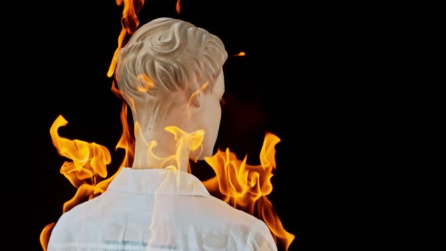 slo mo ld female mannequin in a white shirt catching fire - shirt stock videos & royalty-free footage