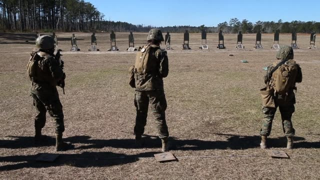 female marines shoot rifles during a combat marksmanship course at marine combat training on february 20, 2013 at camp lejeune, north carolina. since... - us marine corps stock videos & royalty-free footage