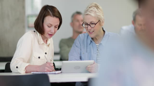 female mature students working together on a course - self improvement stock videos & royalty-free footage