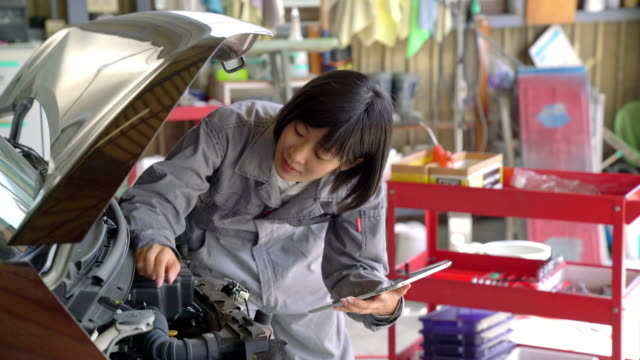 female mechanic checking the engine of a car - engineer stock videos & royalty-free footage
