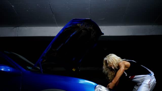 Female mechanic fixing car