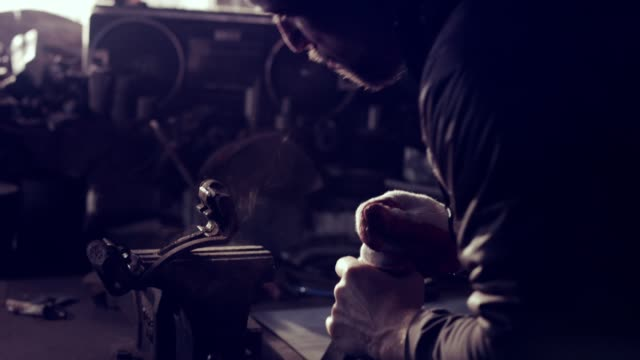 female mechanic in a workshop brushing old metal car brake - stereotypically working class stock videos and b-roll footage