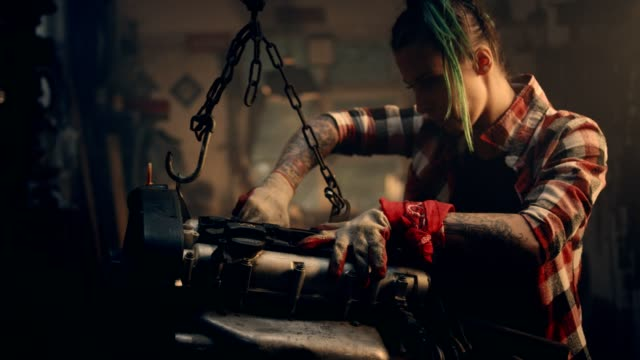 female mechanic in a workshop. fixing engine - females stock videos & royalty-free footage