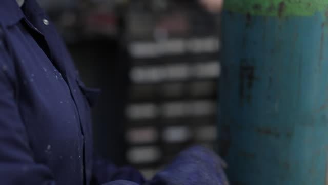 female mechanic prepares herself for welding - welding helmet stock videos & royalty-free footage