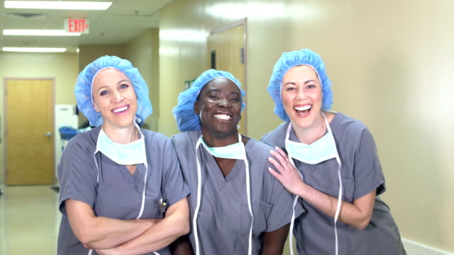 female medical team in hospital, wearing scrubs - scrubs stock videos & royalty-free footage