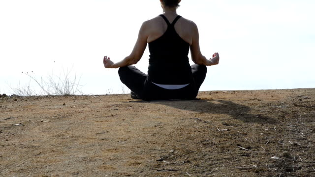 Female Meditator on Hilltop Breathing In