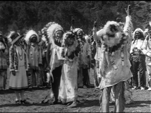 female member of sioux nation native american tribe placing chief headdress on us president calvin coolidge during his vacation ms coolidge wearing... - headdress stock videos & royalty-free footage