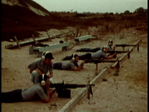 1979 montage female member of the united states navy training sailors at firing range / united states - military training stock videos & royalty-free footage