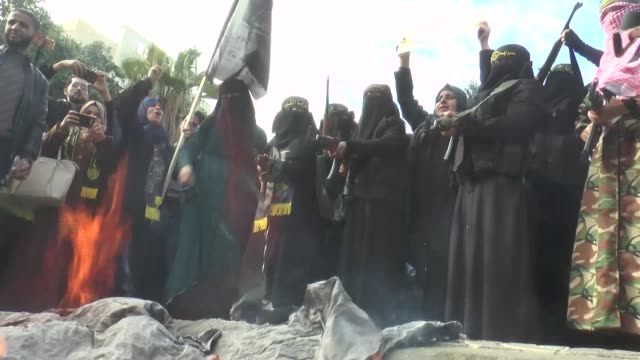 Female members of the Palestinian Islamic Jihad movement take part in a protest against US recognition of Jerusalem as the Israeli capital on...