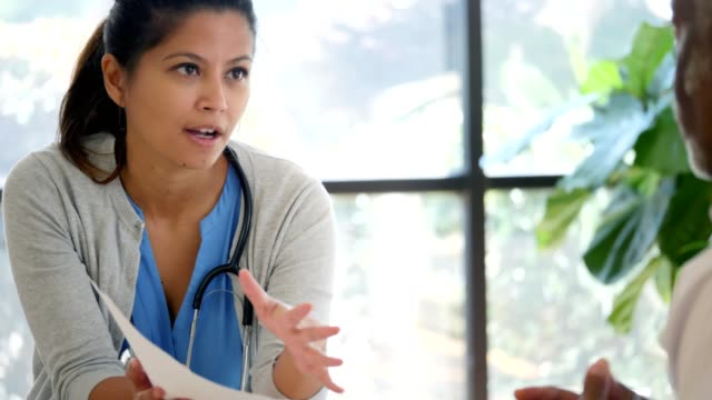 Female mental health professional talks to patient about health issues