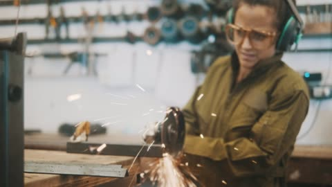 female metal worker using circular saw (slow motion) - welding stock videos & royalty-free footage