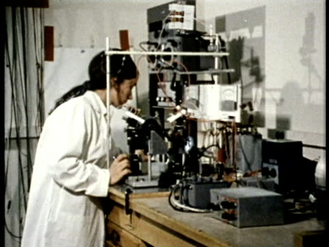 1975 ms zi cu female meteorologist at work in laboratory / united states / audio - 1975 stock videos and b-roll footage