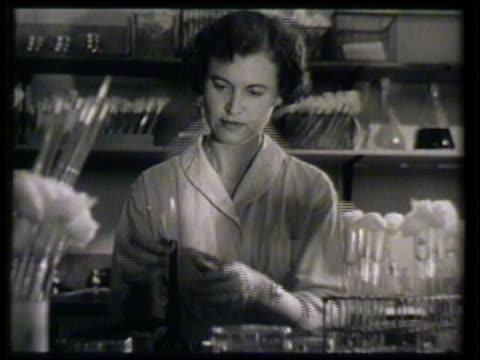 female microbiologist technician in lab testing dried soil mixing it in test tube w/ water repeated running test tube opening over open flame bunsen... - bunsen burner stock videos & royalty-free footage