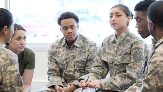 female military counselor leads support group with soldiers - military uniform stock videos & royalty-free footage