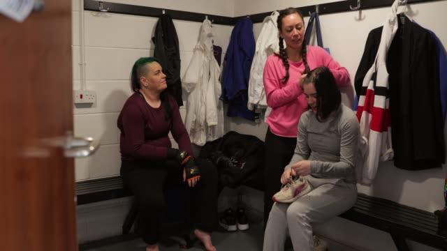 female mma fighters preparing in the locker room - darlington north east england stock videos & royalty-free footage