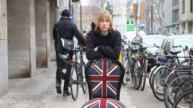Female model and chair with Union Jack logo