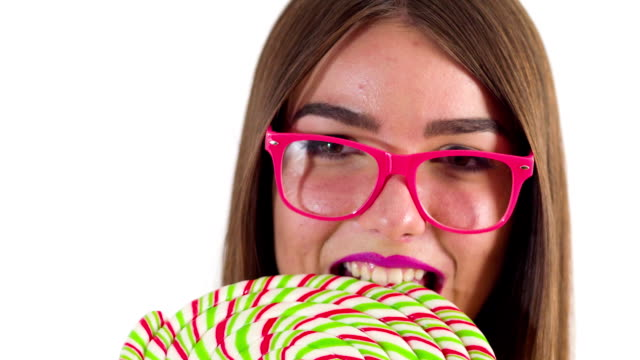 female model eating a lollipop - lollipop stock videos and b-roll footage