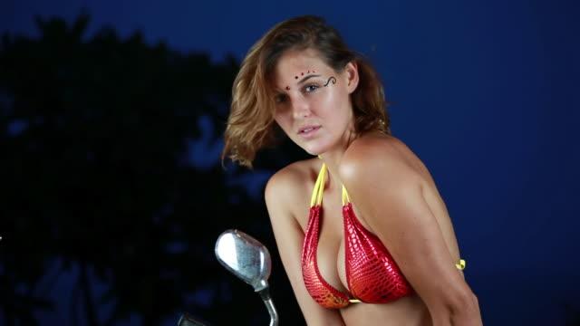 ms female model in bikini on motorcycle with facial jewelry and twilight sky / montezuma, punteranes, costa rica - kelly mason videos stock videos & royalty-free footage