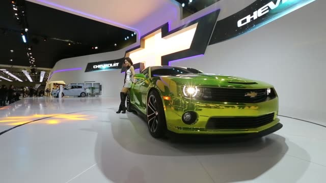 a female model poses by a chevrolet camero car as it rotates on display stand at the company stand at the 2013 seoul motor show in goyang the seoul... - goyang stock videos and b-roll footage