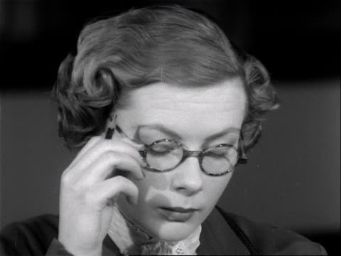 a female model poses while wearing tortoise shell spectacles 1953 - tortoise shell stock videos & royalty-free footage