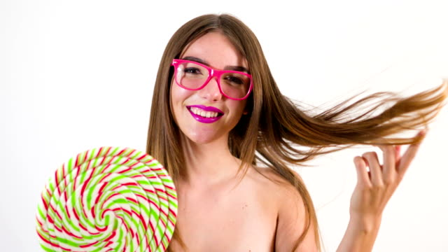 female model posing with lollipop - lollipop stock videos and b-roll footage