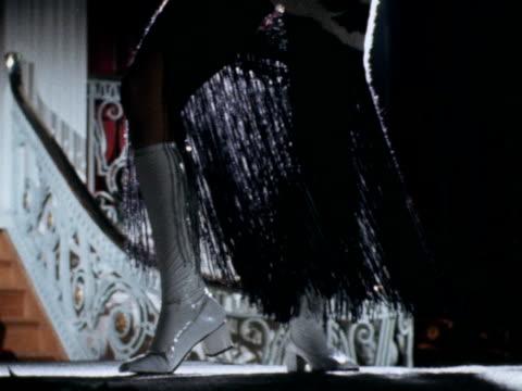 female model wears a patterned fringed dress on the catwalk. 1970. - {{asset.href}} stock-videos und b-roll-filmmaterial