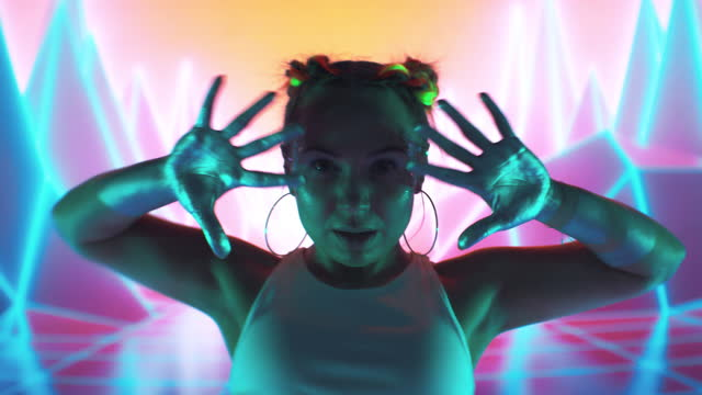 female modern dancer performing on projection background. inside surreal, digital landscape with purple mountains and neon lightning - youth culture stock videos & royalty-free footage