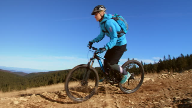 slo mo female mountain biker going down the mountain trail - mountain bike stock videos & royalty-free footage