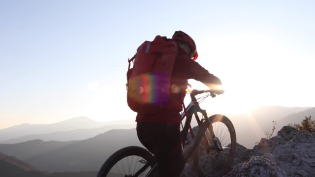 female mountain biker traverses ridge crest - hobbies stock videos & royalty-free footage
