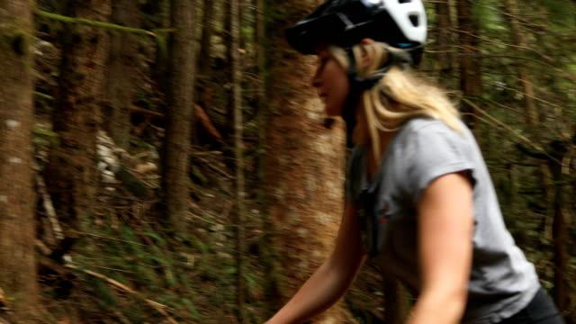 female mountainbiker explores lush rainforest - ascentxmedia stock videos & royalty-free footage